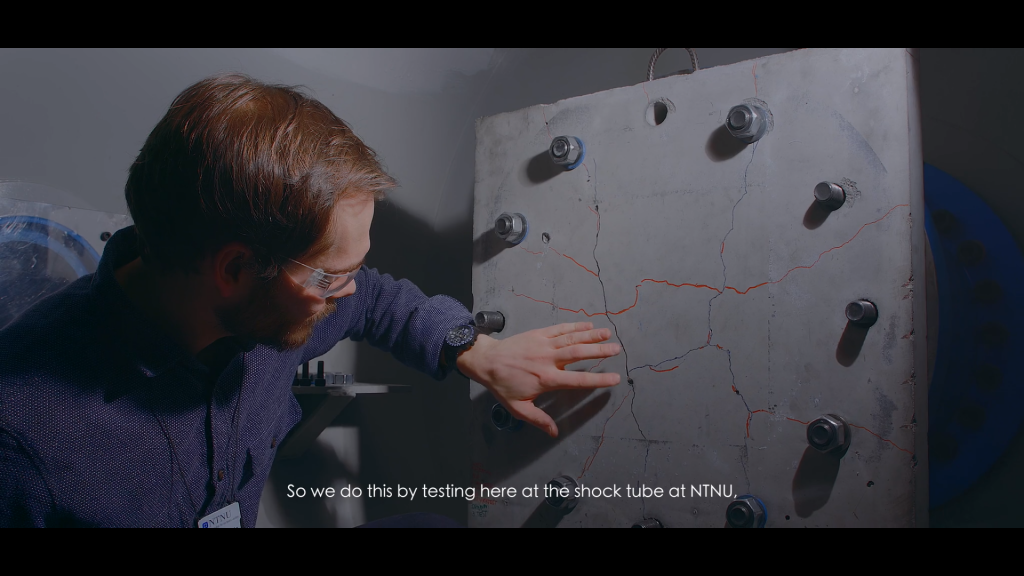 Martin Kristoffersen examining a concrete plate in the shock tube.