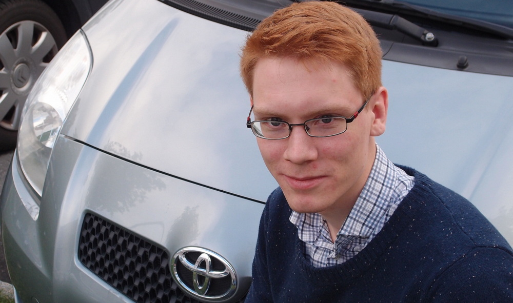"""""""The work for Toyota has given me much better basis for my PhD work than I would have had otherwise,"""" says John Fredrick Berntsen, here in front of a Yaris."""