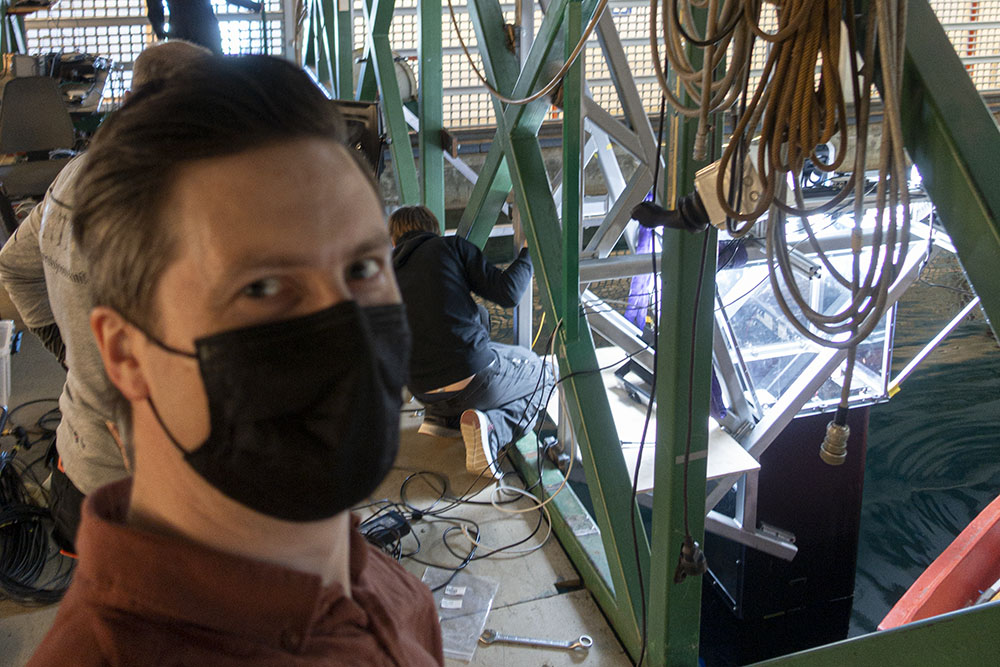Young man wearing face mask in marine lab